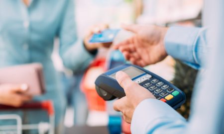 Man holding credit card machine